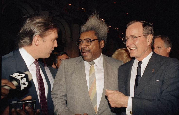 Vice President George Bush stands with Donald Trump and boxing promoter Don King April 12, 1988 in New York City, New York. Bush and his running mate Dan Quayle defeat Michael Dukakis in the Presidential election. His efforts to reduce the deficit failed while creating the lowest growth period since the Great Depression. (Photo by Cynthia Johnson/Liaison)