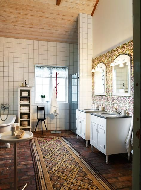 Global styled bathroom - gorgeous tiles, exposed brick floor and eclectic runner mat.
