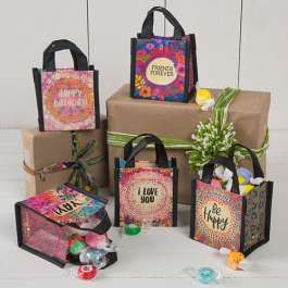 Made of 80% recycled water bottles, our Recycled Gift Bags are a great way to give green. Medium, colorful gift bag with vibrant green forest scene and flower accents surrounding