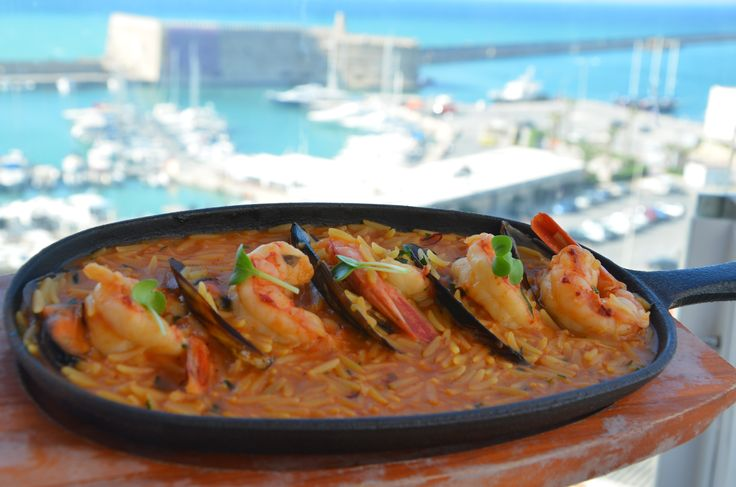"Kritharaki"" Greek risoni with shrimps, mussels and  ""Trikalinos"" dried roe,  flavored with Greek saffron."
