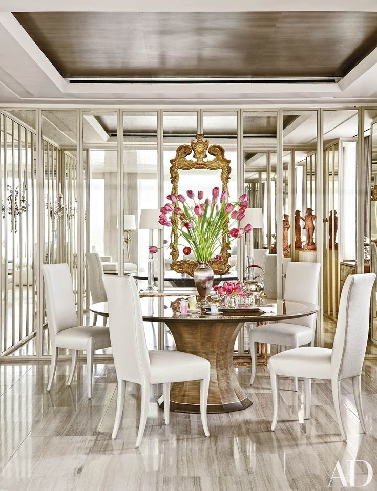 The dining room of a Washington, D.C., apartment sparkles thanks to mirrored panels. Learn how to make an impact with mirrors in your home.