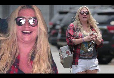 Getting in shape for her tour! Kesha stretches her legs in hotpants