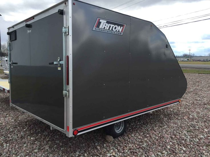 """New 2016 Triton Trailers TC118 Jet Skis For Sale in New York,NY. Triton's TC118 is an 11 foot long deck enclosed trailer looks like the Triton snowmobile trailer and coverall but it is actually a fully enclosed trailer. Taking many of the great features from each style the TC118 is priced in between them both to close the gap between the two traditional styles. The TC118 is another Triton aluminum trailer full of innovation and quality. New for this year, is the """"hip style"""" roof which…"""