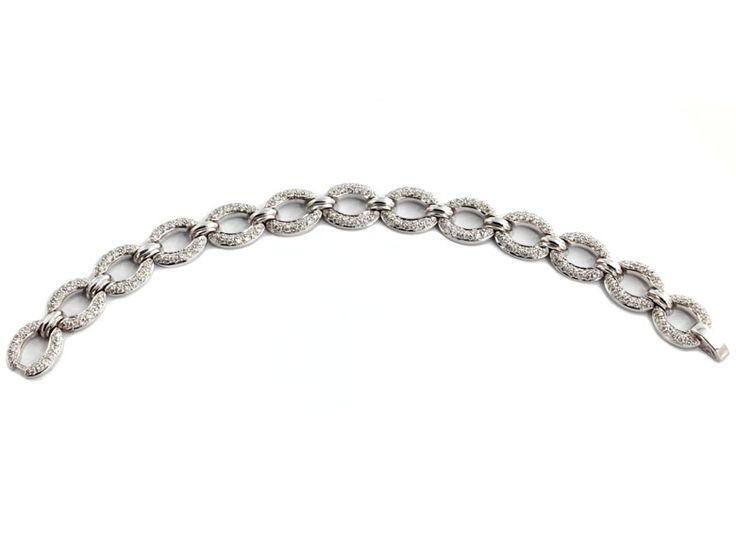 Länge: ca. 18,5 cm. Gewicht: ca. 35,8 g. WG 750. Klassisch elegantes Armband mit ovalen Gliedern besetzt mit kleinen Brillanten, zus. ca. 3,4 ct....