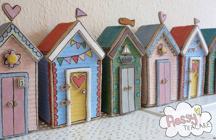 gorgeous colourful beach huts .