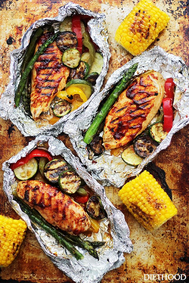 Grilled Barbecue Chicken and Vegetables in Foil by diethood: Tender, flavorful chicken covered in sweet barbecue sauce and cooked on the grill inside foil packs with zucchini, bell peppers and asparagus. #Chicken #Veggies #Foil #Easy