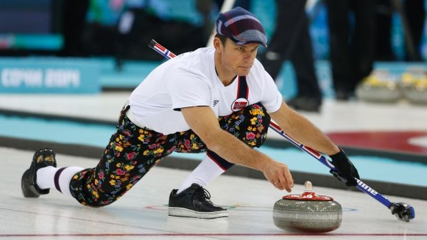 """Norway men's curling uniform, one of nine they will wear during round robin play in Sochi. This one is being described as rose-painting knickers, knee length pants with soccer socks and flat caps also known as """"sixpences"""".  Pictured here is skip Thomas Ulsrud during practice today. February 8, 2014."""