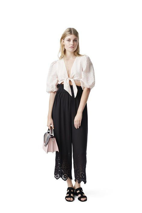 High waisted trousers with wide legs and cut  outs.