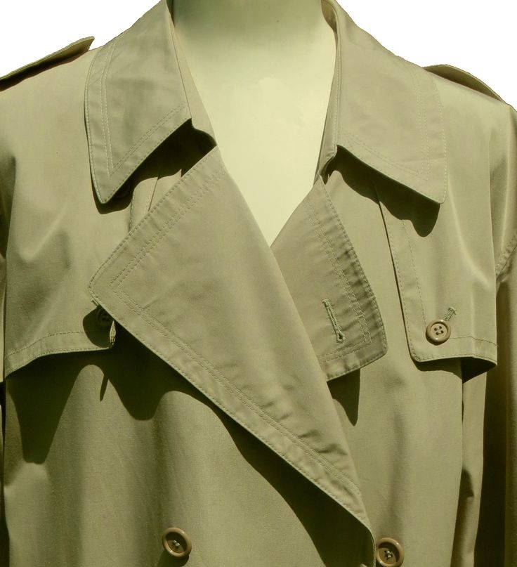 A lightweight all weather light khaki classic trench coat with epaulets, cuff ties, a buttoned back flap, a back vent, two pockets, a fixed belt, inside pockets with a full lining. Had a removable lining which is missing. Superb quality, stylish finishes and in excellent condition.