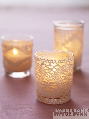 lace wrapped votive holders - I'd like to add a little lace to the table decor, it gives a little vintage feel to our very modern color scheme - MP