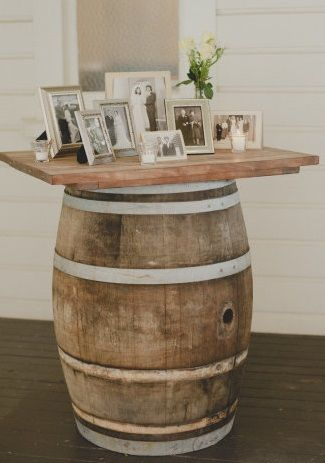 Love this whiskey barrel table! Kind of reminds us of ours ;) http://libertypartyrental.com/products/whiskey-barrel-w-live-oak-slab/