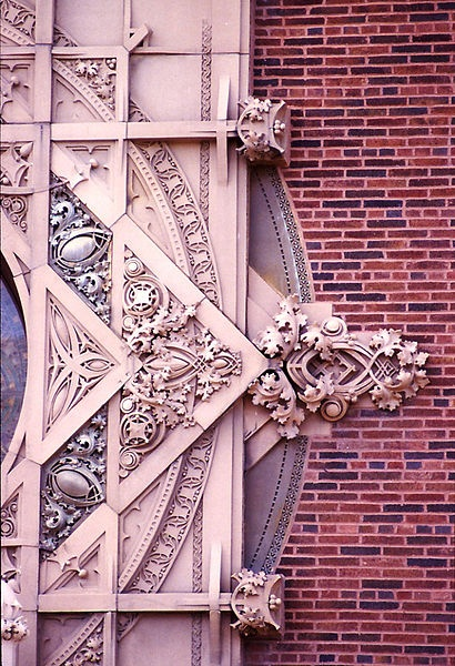 Detail from the cartouche of Merchants National Bank, Grinnell IA, 1914, Louis Sullivan, architect.  The color and design are wonderful; it surrounds a large round window on an otherwise plain, rectangular building.