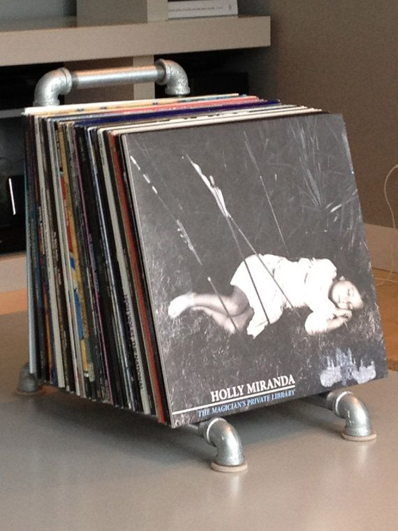 Color me intrigued could be used like a bookend too 65 for Diy vinyl storage