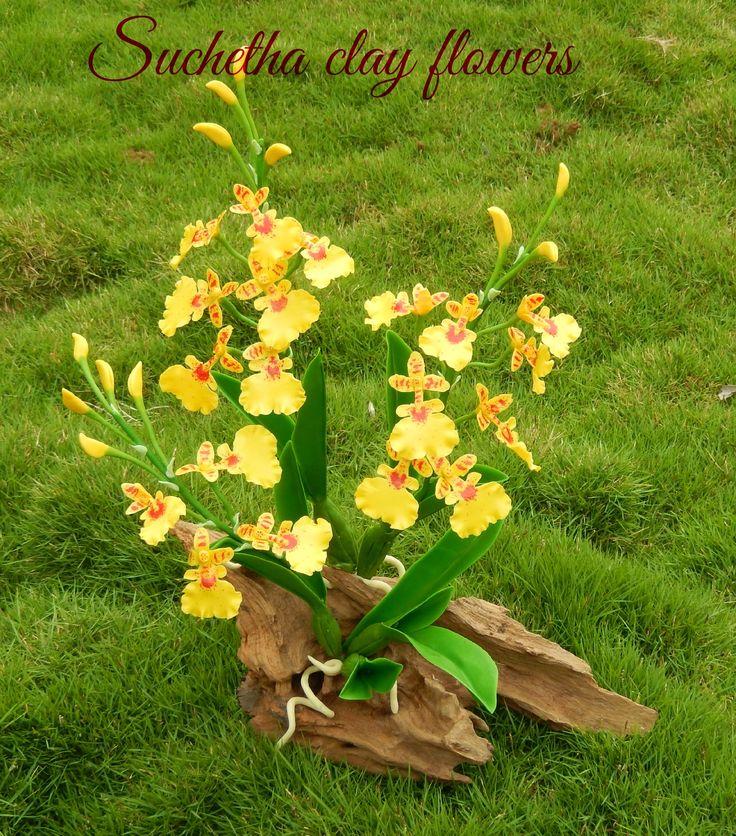 Oncidium Orchid flowers... Handmade clay flowers... https://www.facebook.com/suchethaclay?ref=hl