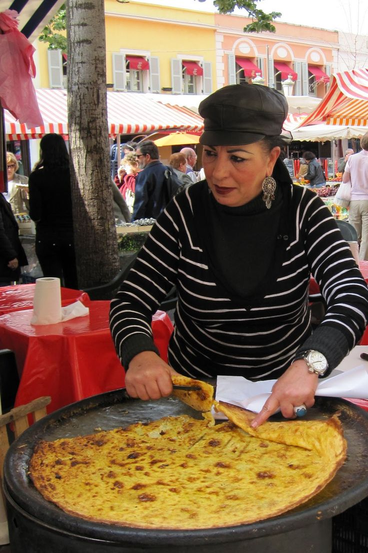 Socca, a Provencal street food similar to a flat pancake made of chickpeas, garlic and olive oil, in Nice,French riviera, France