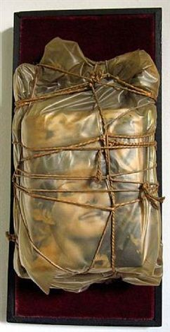 Christo and Jeanne-Claude (born 1935) Title: Wrapped Magazine (Claudia Cardinale), 1962 Medium: Polyethylene, ropes and magazines mounted on red velvet and wood Size: 48 x 23 x 23 cm. (18.9 x 9.1 x 9.1 in.)