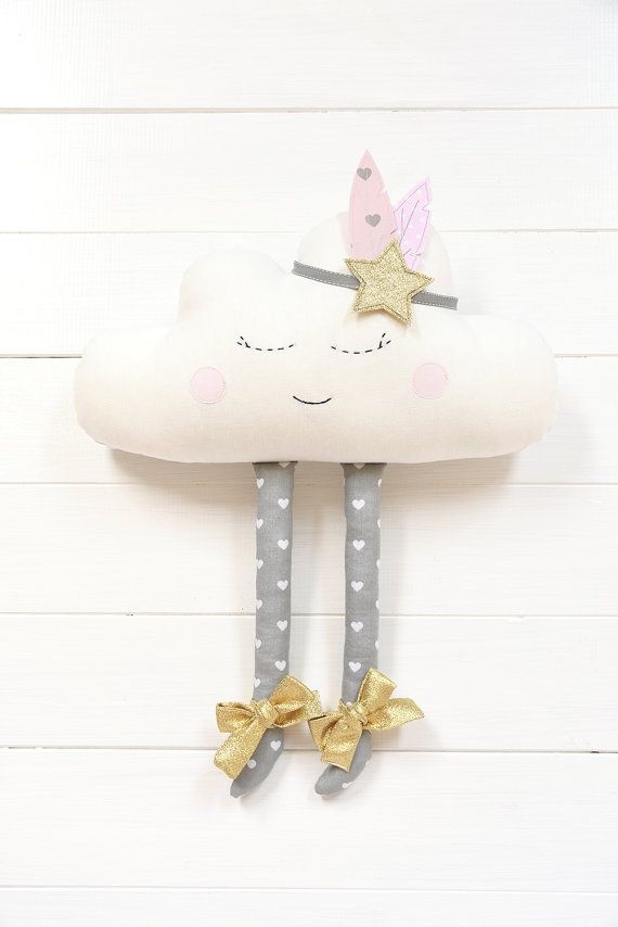 This sweet sleeping cloud is an adorable gift for baby shower and also for nursery or kids room decoration. The cloud is made of cotton fabrics, has cute golden bows and removable warbonnet with shiny star in the middle. It's firmly stuffed with non-allergenic polyester fiber. Eyes and mouth are carefully hand embroidered. Measures approximately : 46cm x 37cm (considering the legs) 18 x 14,5 The cloud can be made to order in the colors and patterns of your choice :) Thank you for looking
