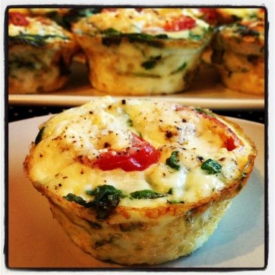 Tomato-Arugula-Feta Egg White Cups | Only 26 scrumptious calories per serving! Gotta love getting veggies in at breakfast too! RippedRecipes.com