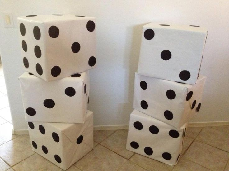 Dice made from LARGE boxes, covered in white wrapping paper and cut out circles. Super Easy and a great decoration.