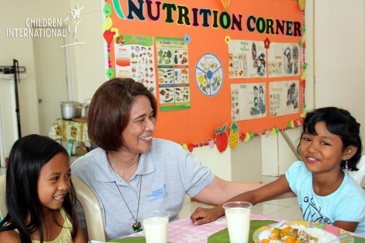 Sponsored children enjoy a healthy meal and learn about nutrition at an event in Quezon City, Philippines.