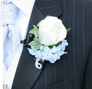 Matt's boutonniere was a simple white rose with a bit of blue trim. He wore a pin-striped suit and a light blue tie.