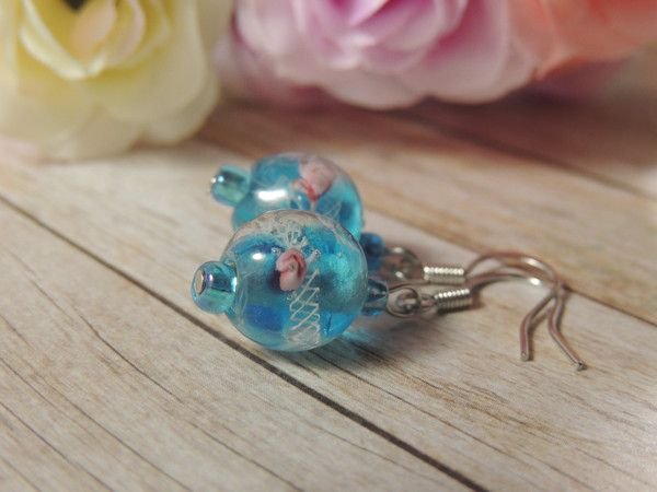 Made with my favourite blue lampwork beads, these earrings feature dainty pink roses and an intricate white lacework pattern, a pair of earrings that are sure t