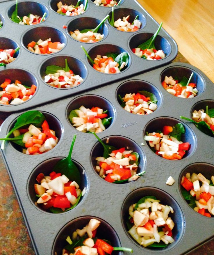 Eggs on the go - sprayed with pam and the fresh veggies are in the tins ready for the eggs to be poured onto them
