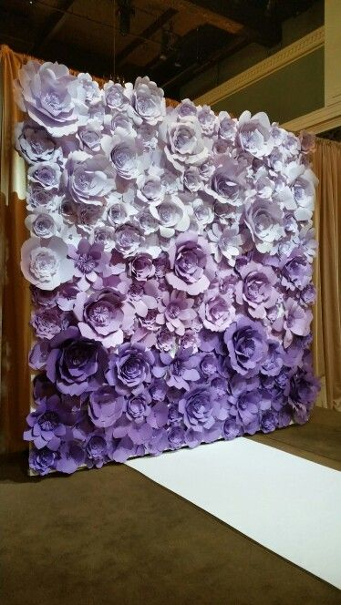 This beautiful ombre purple paper flower wall  ….For Maternity Inspiration, Shop  here >> http://www.seraphine.com/us   Beautiful spring wedding | Spring Wedding | celebration | wedding themes  | bridesmaid | groomsmen | spring wedding ideas |  decorations |  wedding planning | wedding ideas | style chic |  spring wedding venues |beautiful colours | flowers |