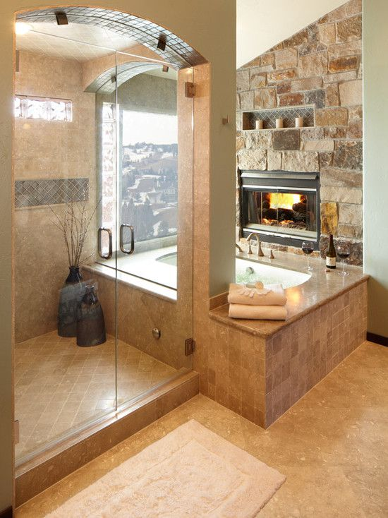 Double headed shower with fire place and soaking tub.