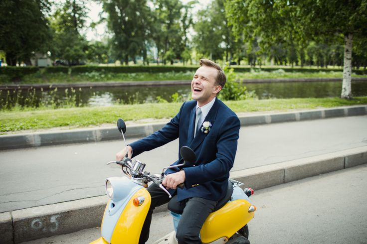 Funny bridegroom driving moped
