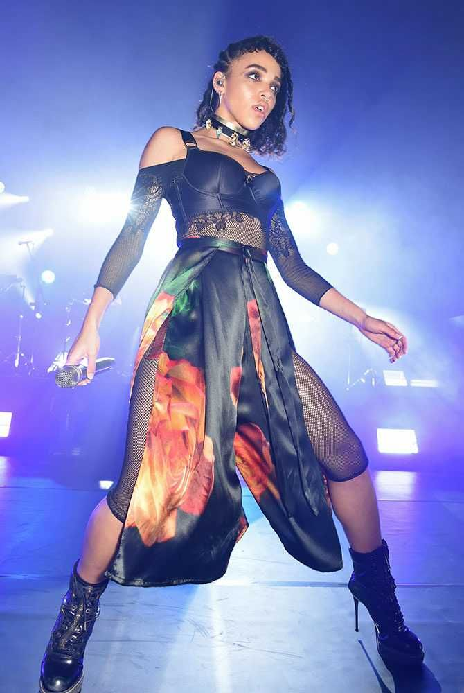 ELLE loves... FKA Twigs performs at the MAC London Fashion Week SS16 party, wearing a fishnet body suit with black satin lingerie and a floral silk skirt.