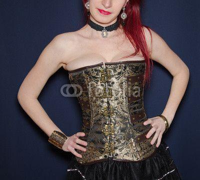 Woman in steampunk style corset, studio shot! #Steampunk #Gothic #Dark #Corset #Dress #Woman #Portrait #RedHair #Fashion #Model #Breast #Collar #Lips #Makeup #Cosmetics #Skin #Beauty #Steam-Punk
