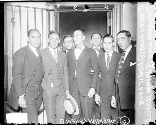 Portrait of Allan Loeb, Ernest Loeb, Richard Loeb, Nathan Leopold, Jr., and his brother Foreman Leopold, standing in front of a doorway in a room in Chicago, Illinois