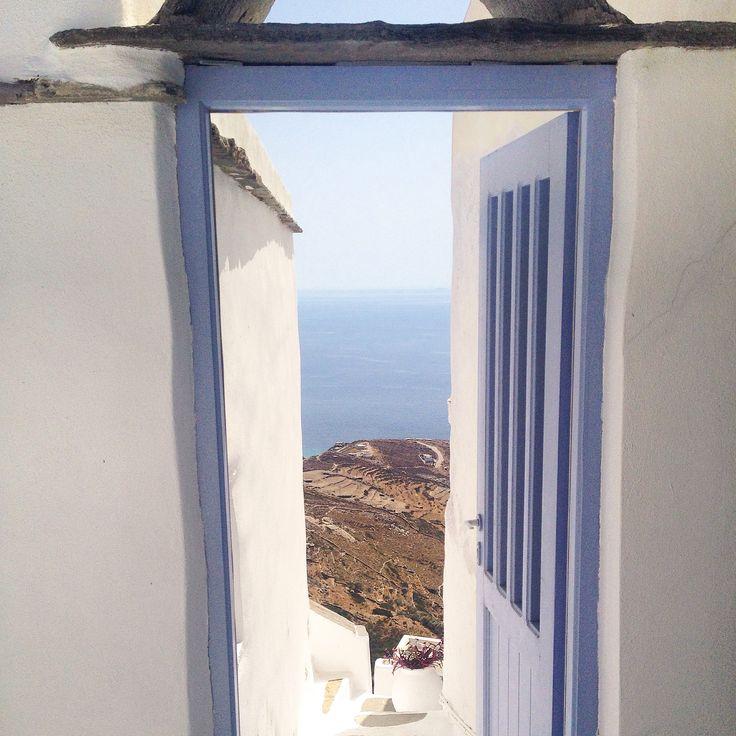 Open door. Cyclades. Sea view. Greek summer, islands. Tinos. Greece