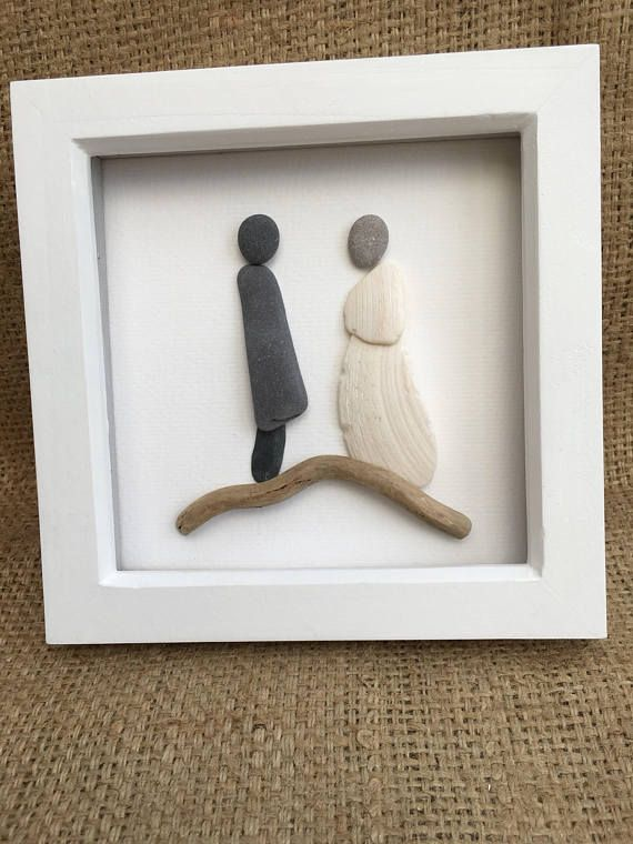 Wedding Pebble art picture. A unique wedding present for the Bride and Groom. It can be personalised with a simple message to celebrate their wedding day. An unusual quirky wedding present for the happy couple. I have made this picture from pebbles, shells and a piece of