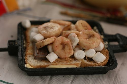 Pie Iron Recipe #4: Mutter Butters - bread, peanut butter, chocolate chips (or bar), bananas, mini marshmallows