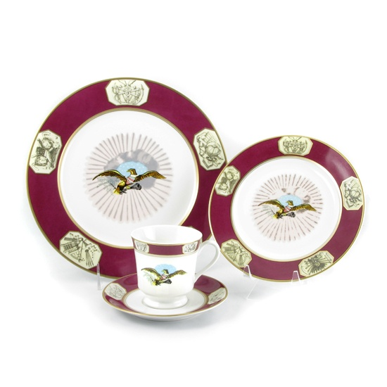"""The china of James Monroe was the first White House china created solely for presidential use. A Napoleonic eagle was in the center of the plates. The eagle carried a red, white, and blue banner reading """"E Pluribus Unum""""."""