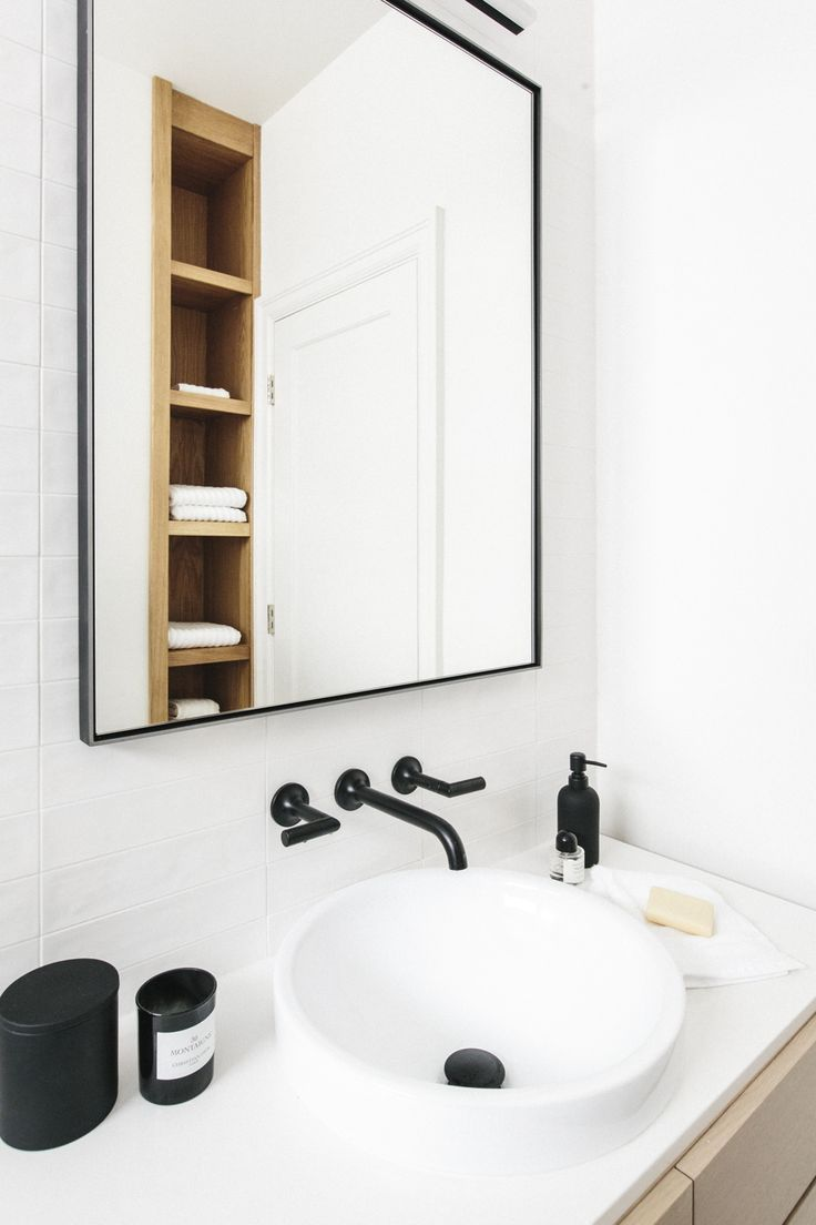 white bathroom with black accents