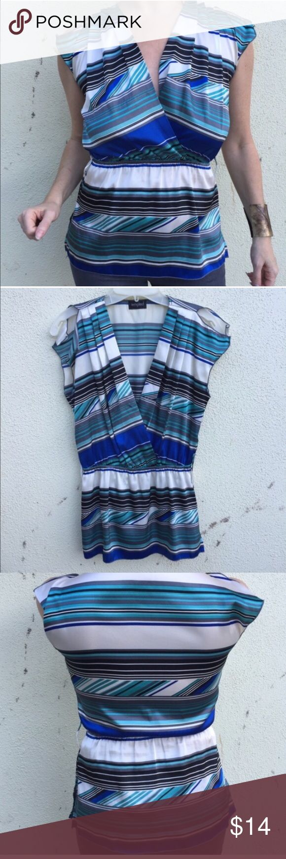 Blue white striped TOP blouse faux wrap tunic SZ M Satiny top with stripes, faux wrap neck and elastic waist creating almost a peplum silhouette. Great with straight skirts! Polyester. Fits medium. (O17) Tops Blouses