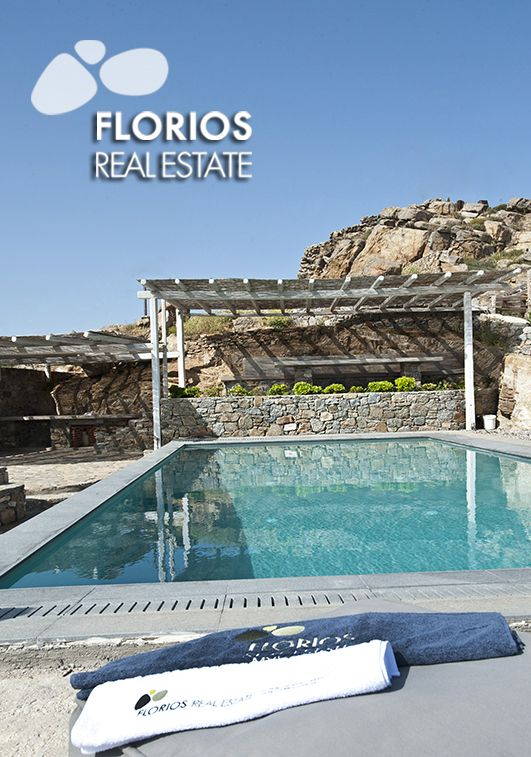 The swimming pool is directly accessible from the upper floor as well as the lower floor by an external stairway. The swimming pool area has a distant view over the port in the town of Mykonos and the characteristic rocky hills of the island. The guest area veranda and the patio have superb views of sunset. Villa for Sale on Mykonos island Greece. FL1486 http://www.florios.gr/en/mykonos-property/9.html