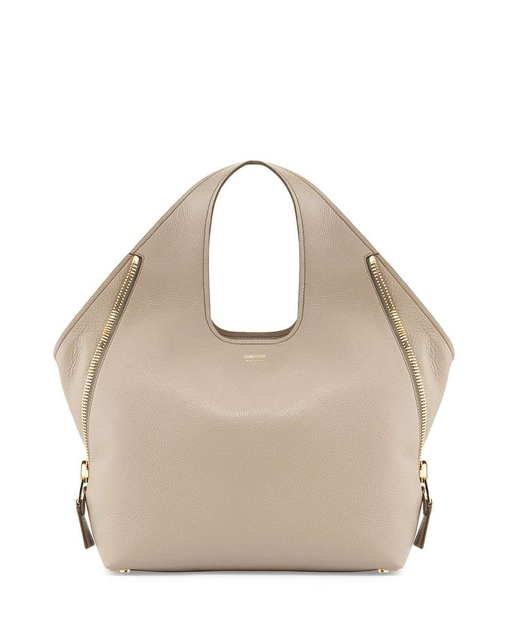 Calf leather with signature Tom Ford yellow golden hardware. Cutout top handles. Open top with center snap-tab. Winged sides with zip details. Inside, Alcantara lining and zip pocket. Feet protect bag