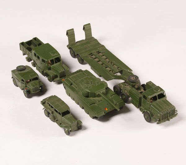 """Dinky military toys; flatbed carrier with tank, three trucks. 12\"""" long. Good condition, tires off one truck."""
