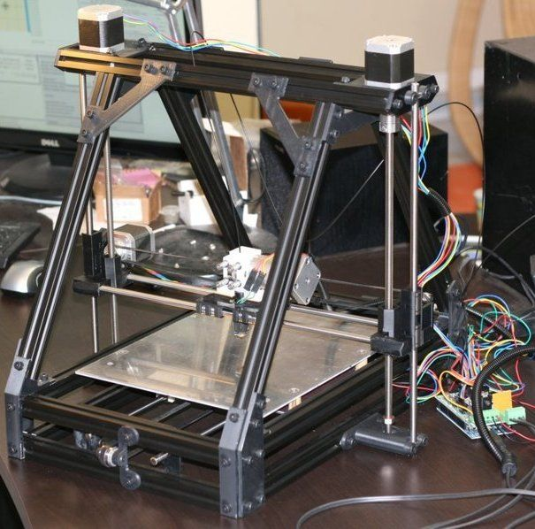 This a RepRap, or a rapid replicating machine, also known as a 3-D printer.  I'm going to build one as soon as I have enough shop space and learn to use microcontrollers.  It can make just about anything out of plastic with a 3-D CAD drawing.  There's a company in Europe using this technology with lasers and titanium powder to make prosthetic jawbones.