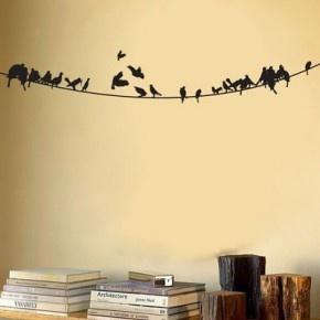 Muursticker met vogels op een lijn.