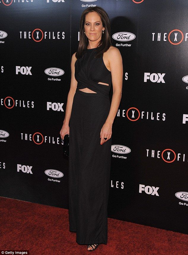 Keeping it simple: Annabeth Gish - who is reprising her role of agent Monica Reyes - was simply chic in a black floor length dress with peek-a-boo cut outs
