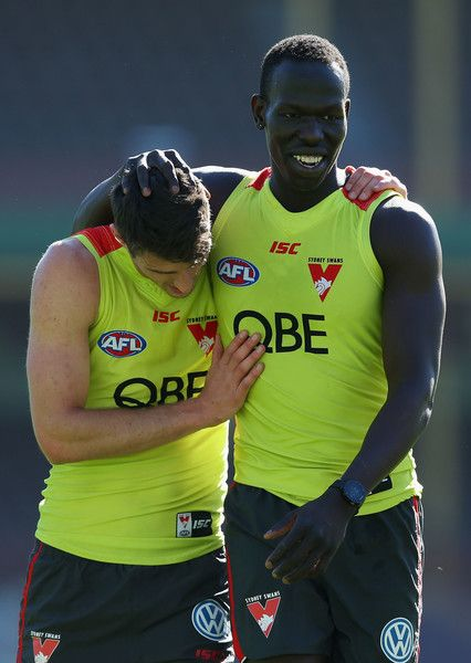 Dean Towers (left) and Aliir Aliir embrace during a Sydney Swans AFL training…