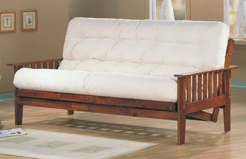 Features:  Style: -Mission/Shaker.  Frame Material: -Wood.  Finish: -Oak.  Primary Material: -Wood.  -The futon needs to be pulled away from the wall in order to fully open.  -Coil Mattress: Yes.  Fut