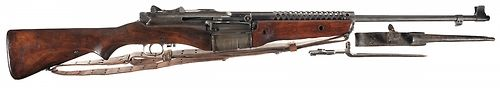 The M1941 Johnson Rifle,  a rifle that is forgotten by many in annals of WW II, the Johnson Rifle was a semi-auto that competed with the M1 Garand at the outset of the war. Invented by Melvin Johnson, the Johnson Rifle used a short recoil system utilizing a reciprocating barrel to cycle the bolt, whereas the M1 Garand used a gas operated system. A truly unique design, perhaps the Johnson's most prominent feature was the used a rotary magazine system, forming a conspicuous bulge.