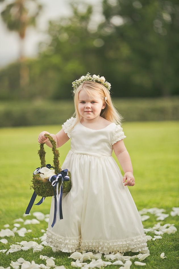 Adorable flower girl with moss basket and flower crown | Orange Turtle Photography via Bridal Musings