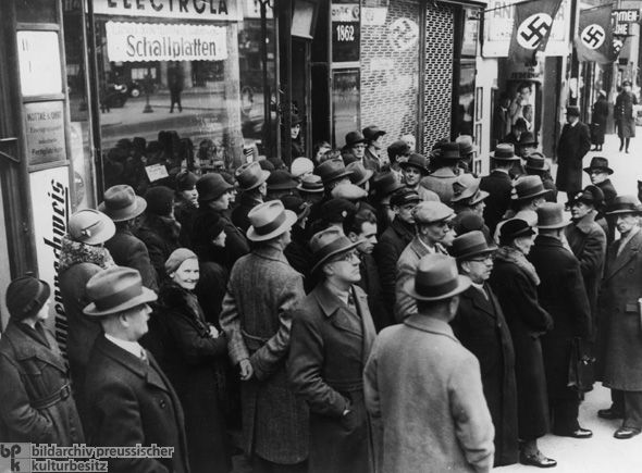 Germans in Front of a Radio Store in Berlin Listen to News of the Invasion of Poland (September 1, 1939) British-French offensive failed to materialize and Poland had been conquered within four weeks, Hitler regained his standing among Germans and was more popular than ever.